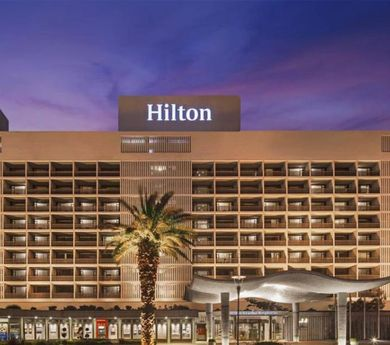 Hilton announces more layoffs, extends furloughs and pay cuts