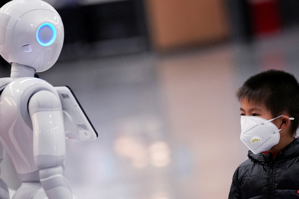 a-boy-watches-a-robot-at-shanghai-pudong-international-airport-source-reuters